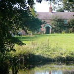 The main Farmhouse B&B from the Lake | Glan Clwyd Isa